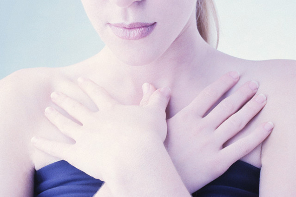Woman's Hands Over Chest