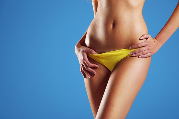 Sexy woman wearing string bikini, close-up of abdomen