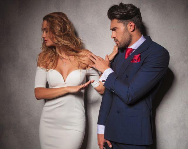 elegant woman is pushing her man away
