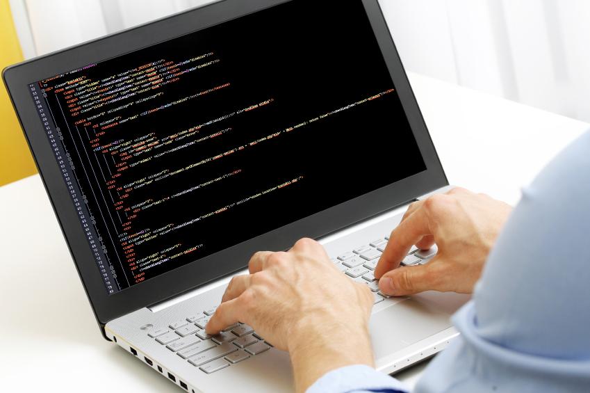 programmer profession - man writing programming code on laptop c