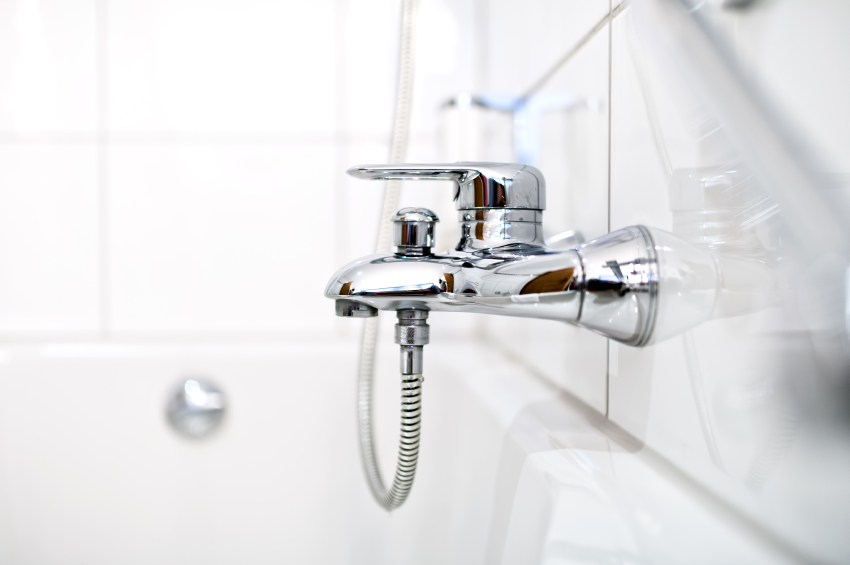 close up of luxury bathroom tap and bathtub in contemporary home
